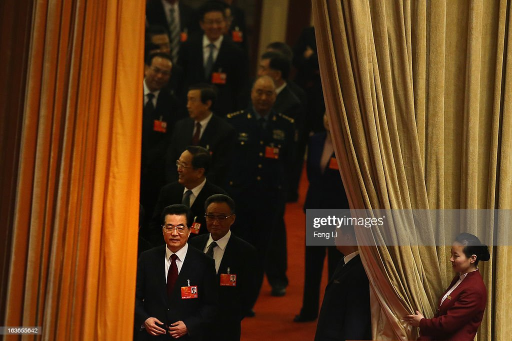 Outgoing Chinese President Hu Jintao (Front) arrives for the fourth plenary meeting of the National People's Congress at the Great Hall of the People on March 14, 2013 in Beijing, China. Xi Jinping, general secretary of the Communist Party of China Central Committee, was elected President of the People's Republic of China and Chairman of the Central Military Commission on Thursday.