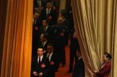 Outgoing Chinese President Hu Jintao arrives for the fourth plenary meeting of the National People's Congress at the Great Hall of the People on...