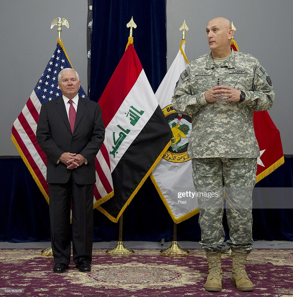 Outgoing Commander of U.S. Forces in Iraq General Raymond Odierno (R) speaks during an award ceremony with U.S. Secretary of Defense Robert Gates (L) during the United States Forces-Iraq change of command ceremony in Baghdad between Odierno and Lieutenant General Lloyd Austin September 1, 2010 in Baghdad, Iraq. The military ceremony signaled a formal end to combat operations in Iraq after seven years of war that claimed more than 4,400 American lives.