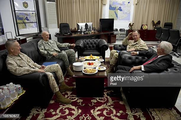 Outgoing Commander of US Forces in Iraq General Raymond Odierno speaks with Commander of US Central Command General James Mattis US Secretary of...