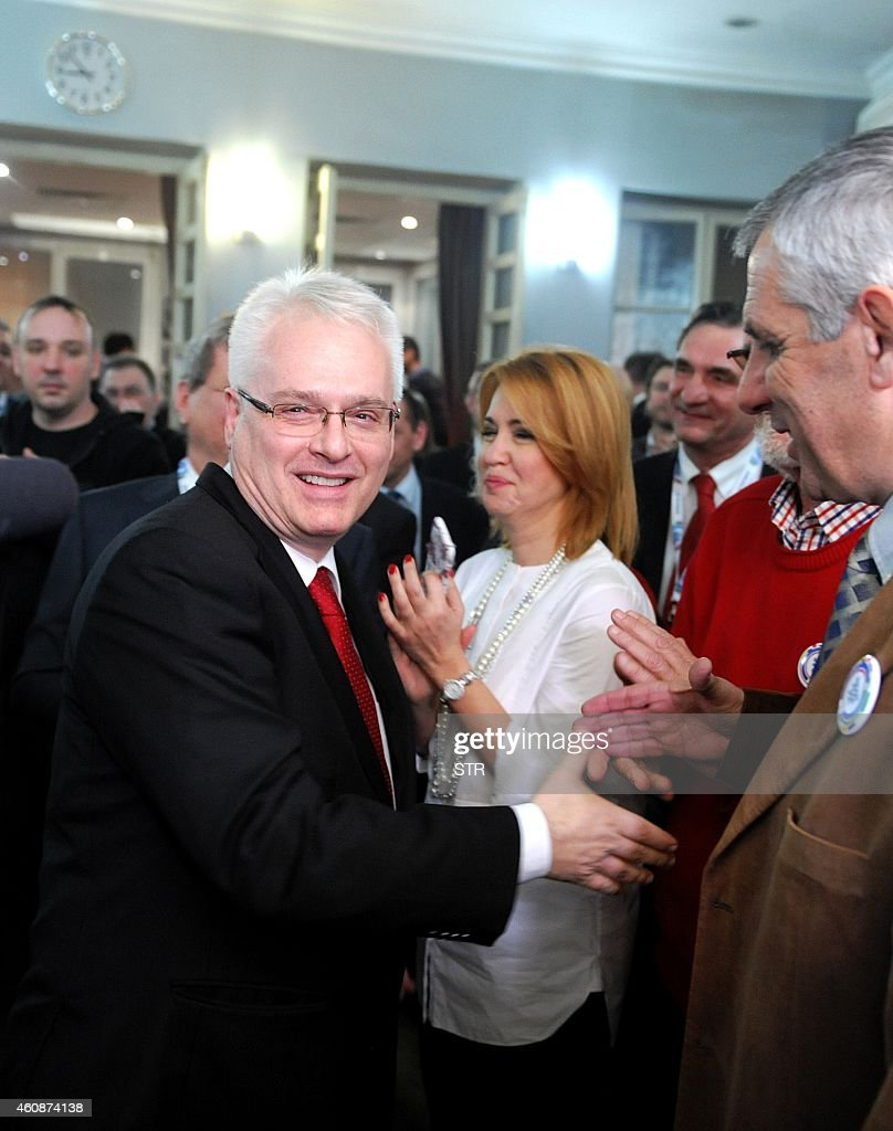 Outgoing croatian President <a gi-track='captionPersonalityLinkClicked' href=/galleries/search?phrase=Ivo+Josipovic&family=editorial&specificpeople=6599425 ng-click='$event.stopPropagation()'>Ivo Josipovic</a> greets his supporters after hearing the first preliminary results of the Croatian presidential elections on December 28, 2014 at his campaign headquarters in Zagreb .roatia's President <a gi-track='captionPersonalityLinkClicked' href=/galleries/search?phrase=Ivo+Josipovic&family=editorial&specificpeople=6599425 ng-click='$event.stopPropagation()'>Ivo Josipovic</a> and his conservative rival on Sunday headed for a January run-off following a tight first round vote in a country battling a severe economic crisis.