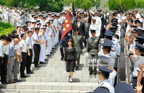 Outgoing Defense Minister Tomomi Inada is seen off by staffs as he leaves the Defense Ministry on July 31 2017 in Tokyo Japan