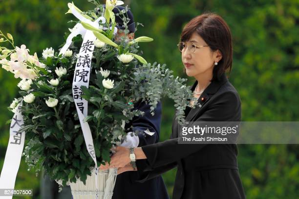 Outgoing Defense Minister Tomomi Inada offers a flower to the memorial prior to leaveing her post at the Defense Ministry on July 31 2017 in Tokyo...