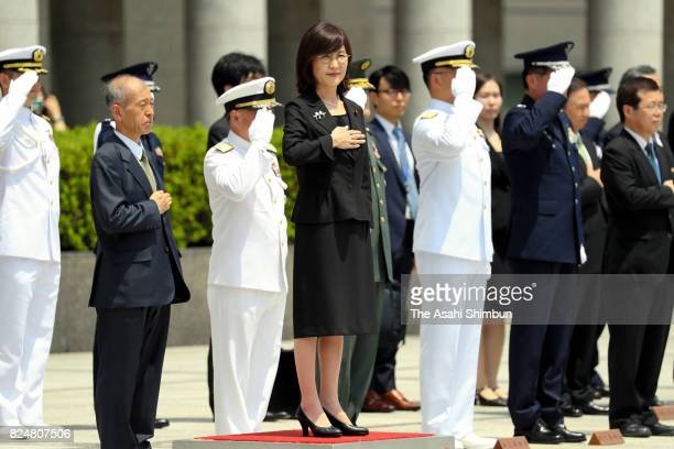 Outgoing Defense Minister Tomomi Inada reviews the honour guard at the Defense Ministry on July 31 2017 in Tokyo Japan