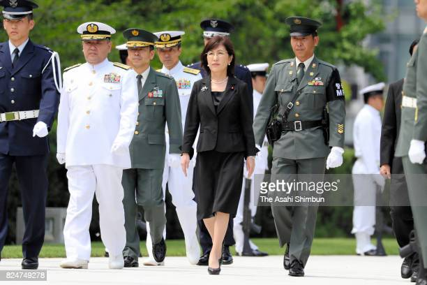 Outgoing Defense Minister Tomomi Inada walks to offer a flower to the memorial prior to leaveing her post at the Defense Ministry on July 31 2017 in...
