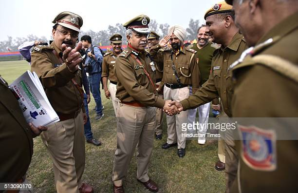 Outgoing Delhi Police Commissioner BS Bassi shakes hands with police officers during his Farewell Parade at Parade Ground New Police Lines Kingsway...