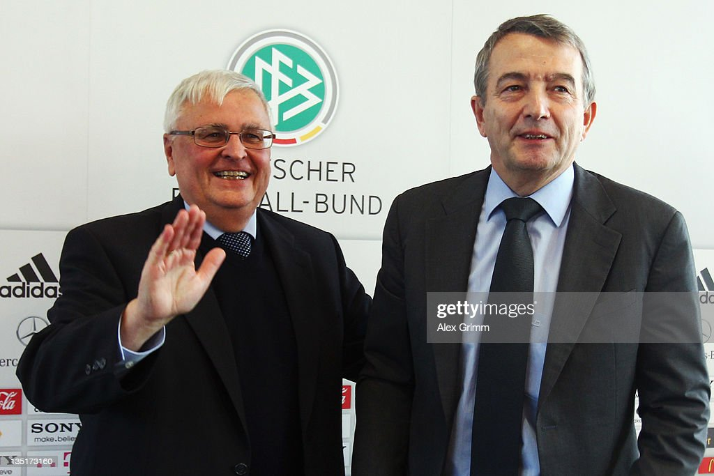 Outgoing DFB President Theo Zwanziger (L) and his designated successor, General Secretary Wolfgang Niersbach, pose after a press conference after a DFB counsel meeting at the DFB headquarter on December 7, 2011 in Frankfurt am Main, Germany.
