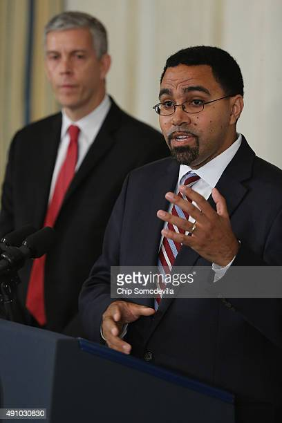 Outgoing Education Secretary Arne Duncan listens as Deputy Education Secretary John B King Jr delivers remarks after being nominated by US President...