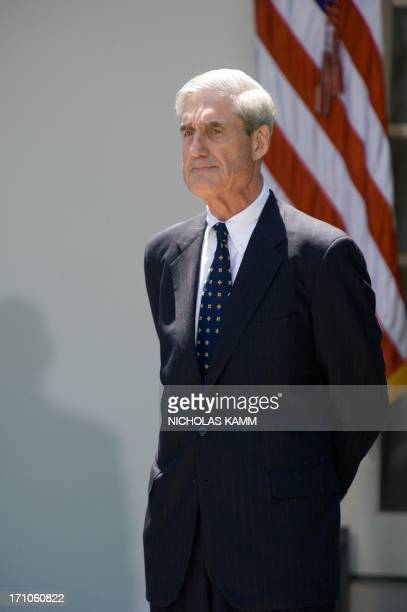 Outgoing FBI director Robert Mueller looks on as US President Barack Obama nominates Jim Comey to be the next director of the Federal Bureau of...
