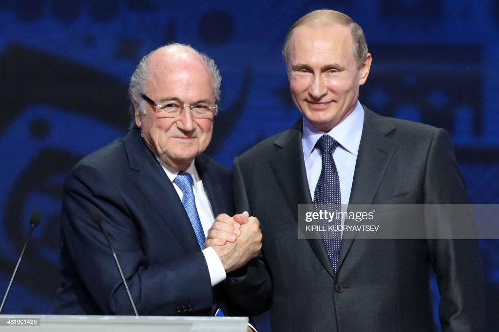 Outgoing FIFA president Sepp Blatter shakes hands with Russian President Vladimir Putin (R) ahead of the preliminary draw for the 2018 World Cup qualifiers at the Konstantin Palace in Saint Petersburg on July 25, 2015.