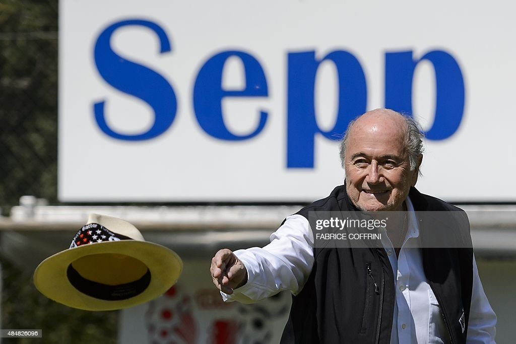 Outgoing FIFA president Sepp Blatter throws his hat prior to kicking a ball at the opening of the 'Sepp Blatter Tournament' on August 22, 2015 in Ulrichen, Blatter's hometown. When Blatter was elected FIFA President in 1998, the town awarded him with the 'honorary burgher' of Ulrichen title and to commemorate the occasion, a football tournament bearing his name was created.