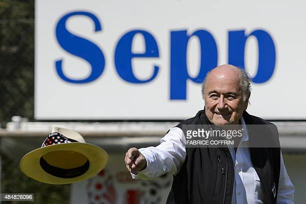 Outgoing FIFA president Sepp Blatter throws his hat prior to kicking a ball at the opening of the 'Sepp Blatter Tournament' on August 22 2015 in...