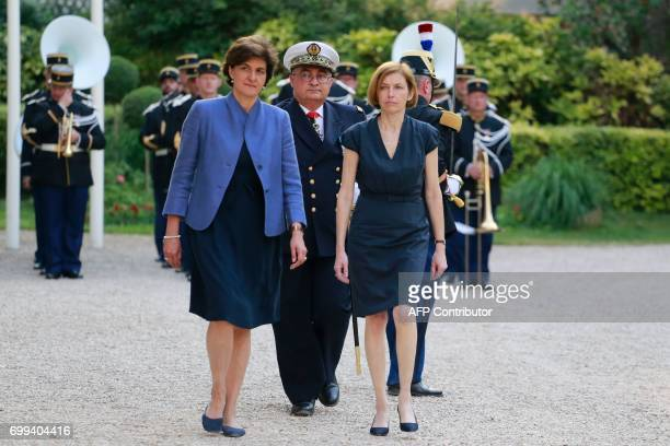 Outgoing French Defence Minister Sylvie Goulard and newly appointed French Defence Minister Florence Parly attend the official handover ceremony at...
