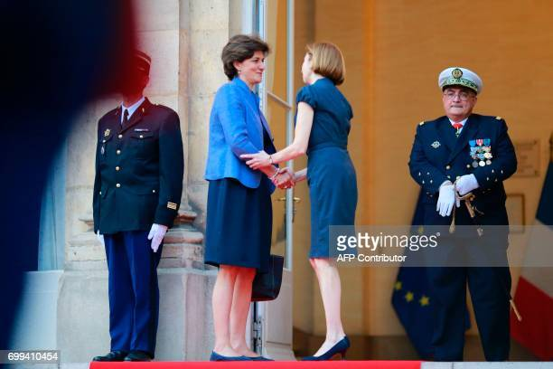 Outgoing French Defence Minister Sylvie Goulard bids farewell to her successor newly appointed French Defence Minister Florence Parly following the...