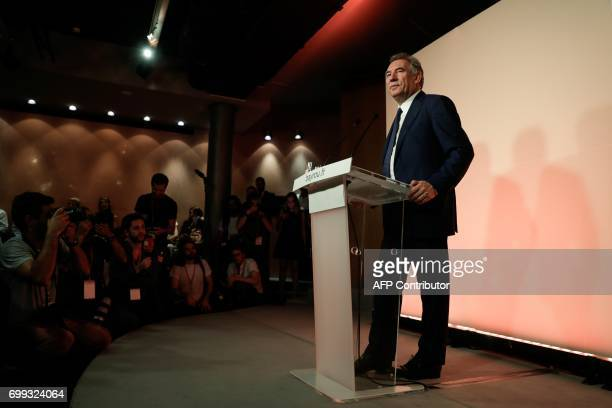 Outgoing French Minister of Justice and Leader of the French MoDem centrist party Francois Bayrou looks on as he addresses media representatives...
