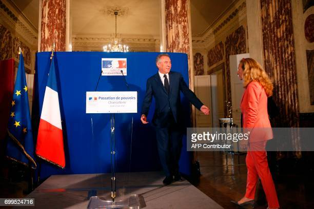 Outgoing French Minister of Justice and Leader of the French MoDem centrist party Francois Bayrou welcomes newly appointed French Minister of Justice...