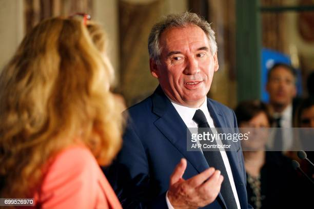 Outgoing French Minister of Justice and Leader of the French MoDem centrist party Francois Bayrou speaks to newly appointed French Minister of...