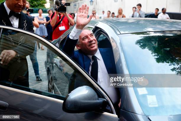 Outgoing French Minister of Justice and Leader of the French MoDem centrist party Francois Bayrou waves as he enters in a car to leave after the...