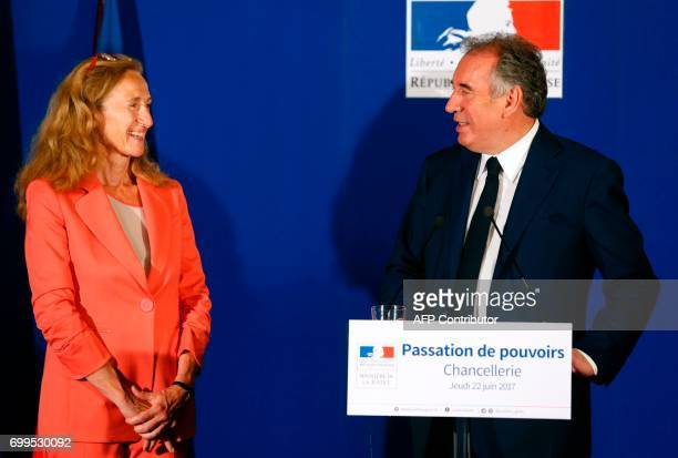Outgoing French Minister of Justice and Leader of the French MoDem centrist party Francois Bayrou delivers a speech next to newly appointed French...