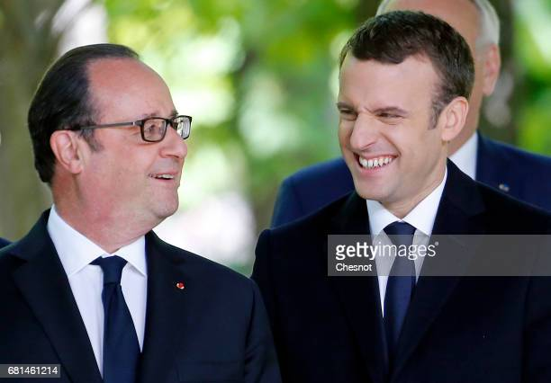 Outgoing French President Francois Hollande and newly elected French president Emmanuel Macron attend a ceremony at the Luxembourg Gardens to mark...