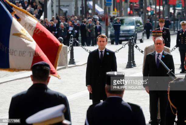 Outgoing French President Francois Hollande and Presidentelect Emmanuel Macron attend a ceremony marking the 72nd anniversary of the victory over...