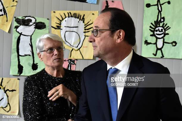 Outgoing French president Francois Hollande leaves after casting his vote in Tulle central France on May 7 in the second round of the French...