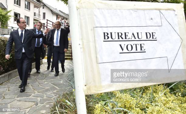 Outgoing French president Francois Hollande waves to supporters after casting his vote in Tulle central France on May 7 in the second round of the...