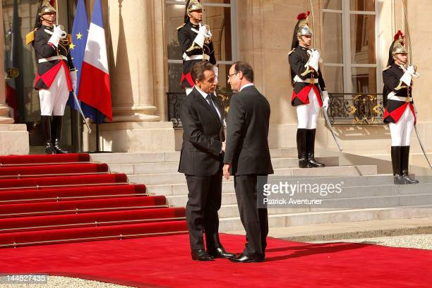 Outgoing French president Nicolas Sarkozy shakes hands with new president Francois Hollande at Elysee Palace on May 15 2012 in Paris France While...