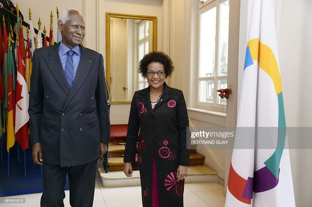 Outgoing General Secretary of the International Organisation of Francophonie (IOF) and former Senegalese president <a gi-track='captionPersonalityLinkClicked' href=/galleries/search?phrase=Abdou+Diouf&family=editorial&specificpeople=216412 ng-click='$event.stopPropagation()'>Abdou Diouf</a> (L) poses with newly-appointed IOF General Secretary, Canadian Michaelle Jean, on January 5, 2015, at the IOF headquarters in Paris.