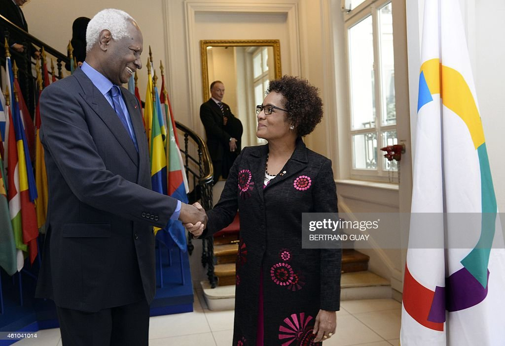 Outgoing General Secretary of the International Organisation of Francophonie (IOF) and former Senegalese president <a gi-track='captionPersonalityLinkClicked' href=/galleries/search?phrase=Abdou+Diouf&family=editorial&specificpeople=216412 ng-click='$event.stopPropagation()'>Abdou Diouf</a> (L) shakes hand with newly-appointed IOF General Secretary, Canadian Michaelle Jean, on January 5, 2015, at the IOF headquarters in Paris.