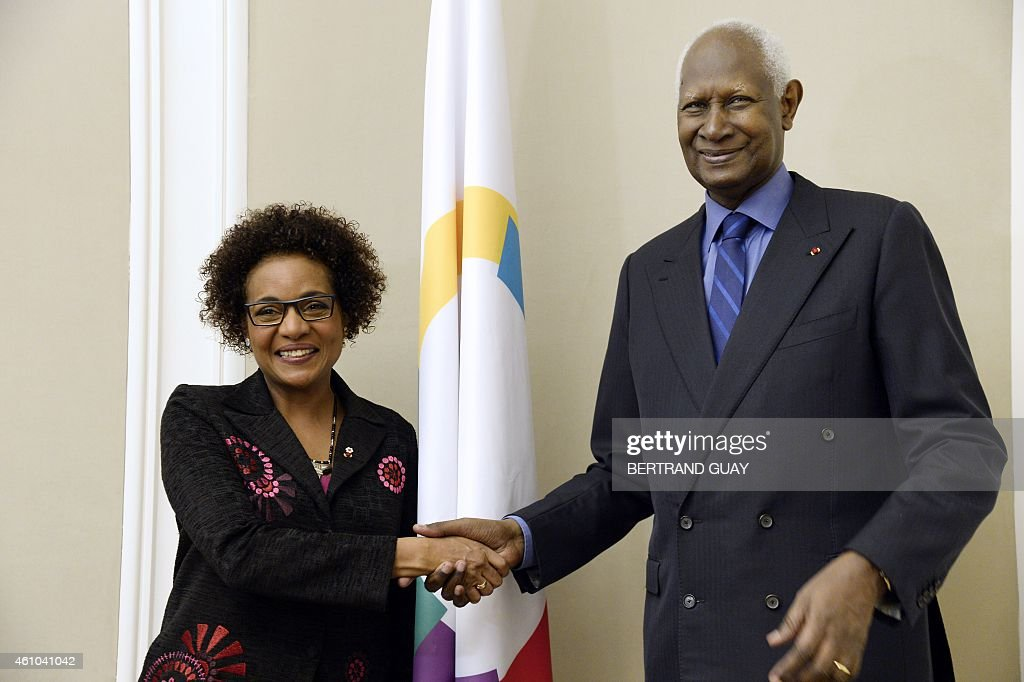 Outgoing General Secretary of the International Organisation of Francophonie (IOF) and former Senegalese president <a gi-track='captionPersonalityLinkClicked' href=/galleries/search?phrase=Abdou+Diouf&family=editorial&specificpeople=216412 ng-click='$event.stopPropagation()'>Abdou Diouf</a> (R) shakes hand with newly-appointed IOF General Secretary, Canadian Michaelle Jean, on January 5, 2015, at the IOF headquarters in Paris.