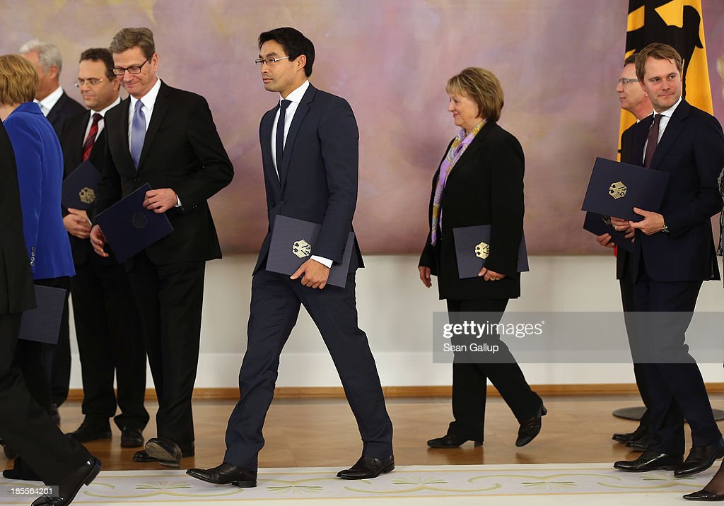 Outgoing German Foreign Minister <a gi-track='captionPersonalityLinkClicked' href=/galleries/search?phrase=Guido+Westerwelle&family=editorial&specificpeople=208748 ng-click='$event.stopPropagation()'>Guido Westerwelle</a>, Vice Chancellor and Economy Minister <a gi-track='captionPersonalityLinkClicked' href=/galleries/search?phrase=Philipp+Roesler&family=editorial&specificpeople=4838791 ng-click='$event.stopPropagation()'>Philipp Roesler</a>, Justice Minister <a gi-track='captionPersonalityLinkClicked' href=/galleries/search?phrase=Sabine+Leutheusser-Schnarrenberger&family=editorial&specificpeople=3026148 ng-click='$event.stopPropagation()'>Sabine Leutheusser-Schnarrenberger</a> and Health Minister <a gi-track='captionPersonalityLinkClicked' href=/galleries/search?phrase=Daniel+Bahr&family=editorial&specificpeople=7622444 ng-click='$event.stopPropagation()'>Daniel Bahr</a>, who are all members of the German Free Democrats (FDP), after they received their dismissal certificates from German President Joachim Gauck at a ceremony for the outgoing German government at Bellevue Palace on October 22, 2013 in Berlin, Germany. The ministers will stay on in their functions until a new government is formed, which will most likely be a coalition between the German Christian Democrats (CDU) and the German Social Democrats (SPD). For the FDP members the ceremony today is especially poignant, as the party failed in recent German elections to receive the 5% minimum of votes necessary to retain its seats in the Bundestag, which means the party no longer has political say on the federal level.