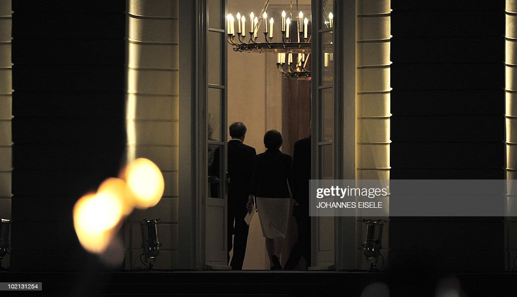 Outgoing German President Horst Koehler and his wife Eva Luise walk away after being honoured by a military parade in the courtyard of Bellevue Palace in Berlin on late June 15, 2010. Koehler, 67, resigned on May 31, 2010 following criticism of comments he had made about Germany's mission in Afghanistan.