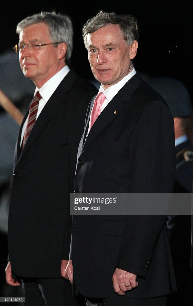 Outgoing German President Host Koehler (R) and interim President Jens Boehrnsen attend the military tattoo at the Bellevue Palace on June 15, 2010 in Berlin, Germany. German President Horst Koehler resigned on May 31 after being criticized for remarks in which he appeared to link military deployments abroad with the country's economic interests.