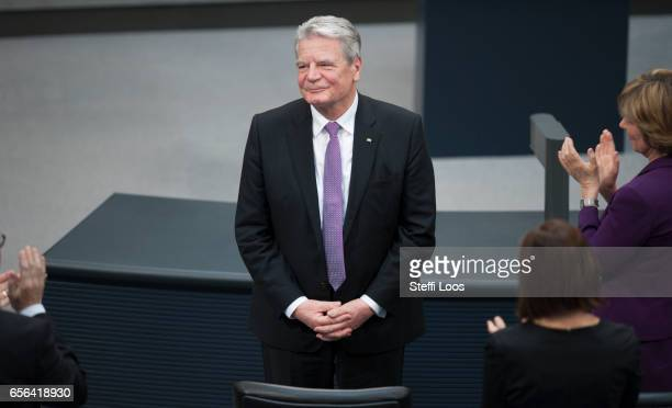 Outgoing German President Joachim Gauck receives applause and standing ovations during the swearingin ceremony of the new President FrankWalter...