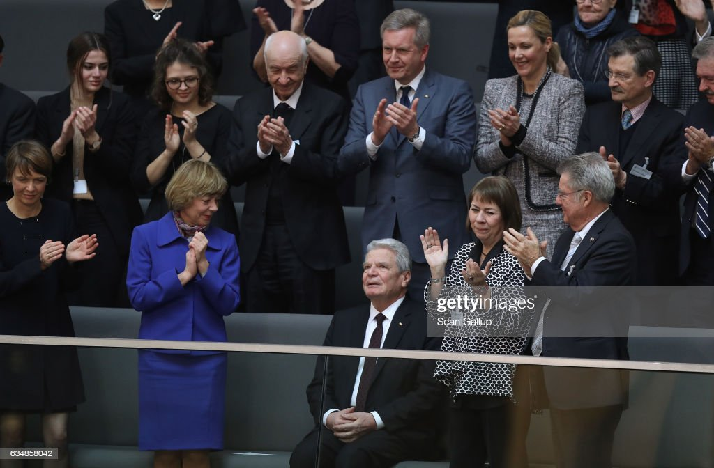 Outgoing German President Joachim Gauck (C) recieves a standing ovation from First Lady Daniela Schadt (L, in blue), former President Christian Wulff (2nd row, C) and Wulff's wife Bettina (next to Wulff) during the election of the new president of Germany by the Federal Assembly at the Reichstag on February 12, 2017 in Berlin, Germany. Frank-Walter Steinmeier, a German Social Democrat (SPD), is Germany's former foreign minister and is likely to win. He will succeed outgoing German president Joachim Gauck.
