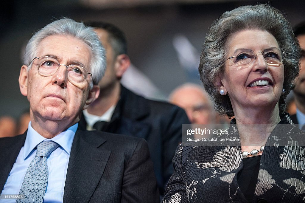 Outgoing Italian Prime Minister Mario Monti (L) and his wife Elsa Antonioli attend a campaign rally for the centrist alliance 'With Monit For Italy' (Con Monti Per L'Italia) and the 'Civic Choice' (Scelta Civica) movement on February 15, 2013 in Rome, Italy. Italians will head to the polls on February 24 and 25 to to elect the new Italian Prime Minister.