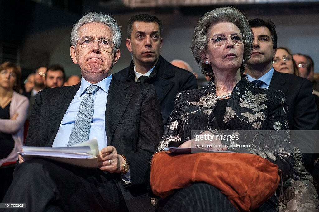 Outgoing Italian Prime Minister <a gi-track='captionPersonalityLinkClicked' href=/galleries/search?phrase=Mario+Monti&family=editorial&specificpeople=632091 ng-click='$event.stopPropagation()'>Mario Monti</a> (L) and his wife Elsa Antonioli attend a campaign rally for the centrist alliance 'With Monit For Italy' (Con Monti Per L'Italia) and the 'Civic Choice' (Scelta Civica) movement on February 15, 2013 in Rome, Italy. Italians will head to the polls on February 24 and 25 to to elect the new Italian Prime Minister.
