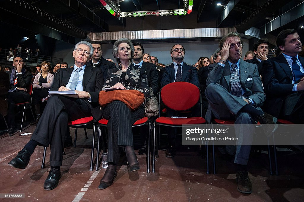 Outgoing Italian Prime Minister <a gi-track='captionPersonalityLinkClicked' href=/galleries/search?phrase=Mario+Monti&family=editorial&specificpeople=632091 ng-click='$event.stopPropagation()'>Mario Monti</a> (L), his wife Elsa Antonioli (C) and President of Ferrari <a gi-track='captionPersonalityLinkClicked' href=/galleries/search?phrase=Luca+Cordero+di+Montezemolo&family=editorial&specificpeople=236070 ng-click='$event.stopPropagation()'>Luca Cordero di Montezemolo</a> attend a campaign rally for the centrist alliance 'With Monit For Italy' (Con Monti Per L'Italia) and the 'Civic Choice' (Scelta Civica) movement on February 15, 2013 in Rome, Italy. Italians will head to the polls on February 24 and 25 to to elect the new Italian Prime Minister.