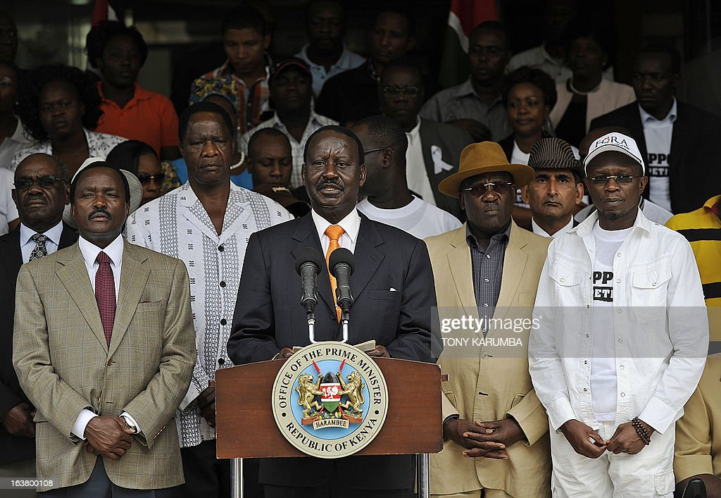 Outgoing Kenya Prime minister Raila Odinga (C) makes an address outside his offices on March 16, 2013 before he formaly filed a petition at Kenya's supreme court to challenge the outcome of the Kenya's general election. Odinga, who was narrowly defeated in presidential polls by Uhuru Kenyatta, filed a formal challenge Saturday against the result. Officials from Odinga's Coalition for Reform and Democracy (CORD) filed the suit at the Supreme Court after Odinga spoke to supporters and journalists in front of his offices. AFP PHOTO/Tony KARUMBA