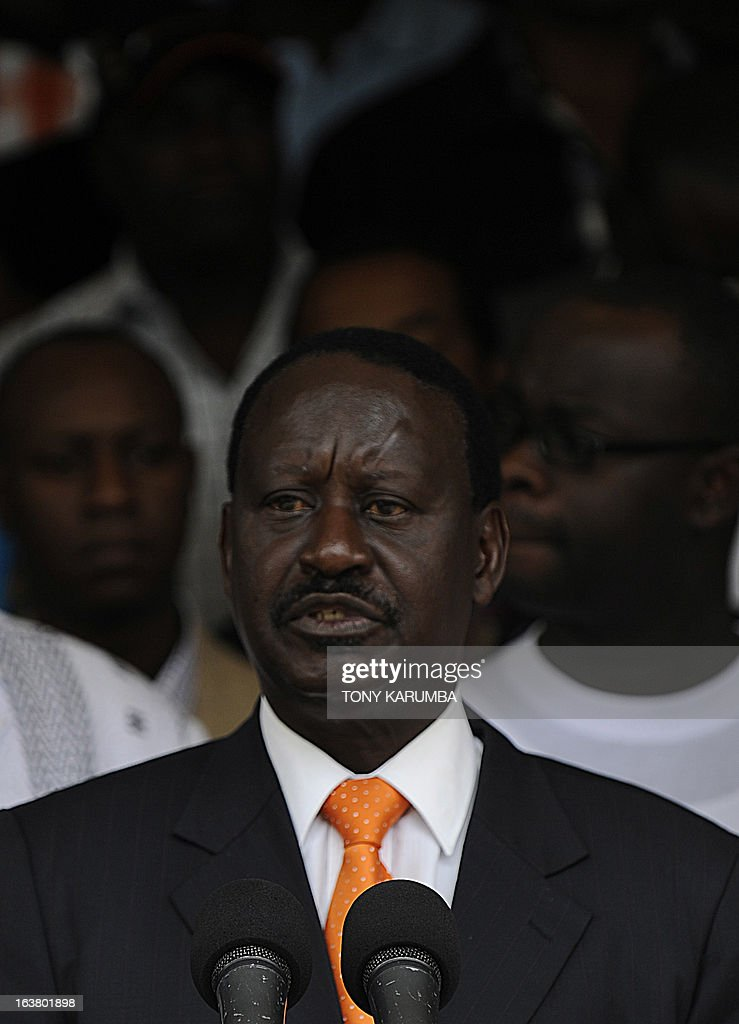 Outgoing Kenya Prime minister Raila Odinga makes an address outside his offices on March 16, 2013 before formally filing a petition at Kenya's supreme court to challenge the outcome of the Kenya's general election. Odinga, who was narrowly defeated in presidential polls by Uhuru Kenyatta, filed a formal challenge Saturday against the result. Officials from Odinga's Coalition for Reform and Democracy (CORD) filed the suit at the Supreme Court after Odinga spoke to supporters and journalists in front of his offices. AFP PHOTO/Tony KARUMBA