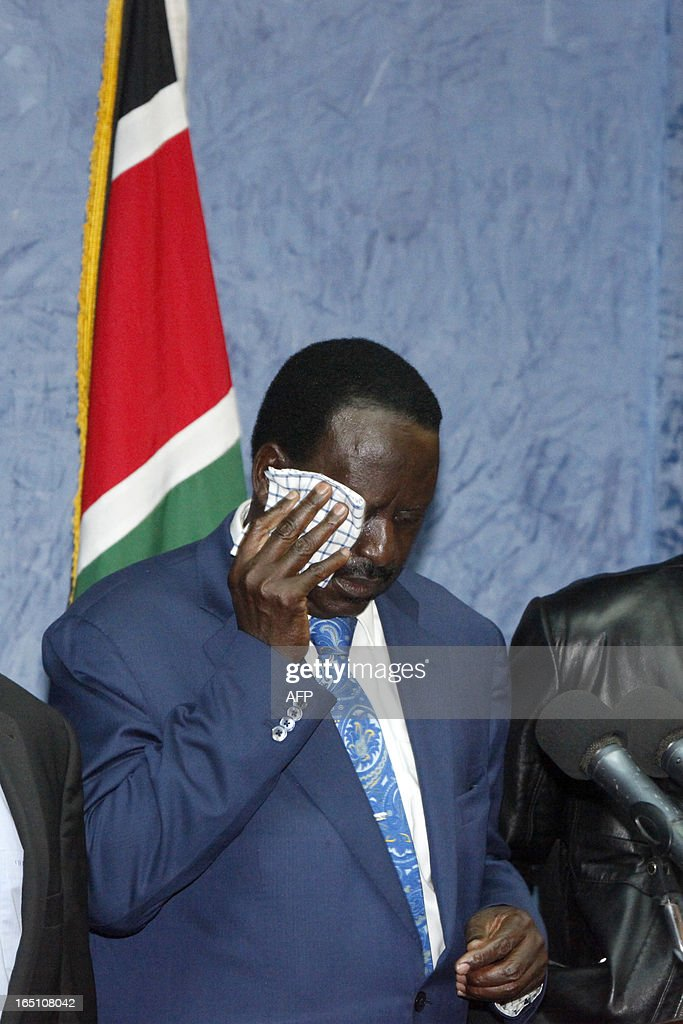 Outgoing Kenyan Prime Minister Raila Odinga wipes his eyes as he addresses the media at a press conference at his office in Nairobi on March 30, 2013. The Kenyan Supreme Court ruled on March 30 on a petition by outgoing Kenyan Prime Minister Raila Odinga challenging the election of contender Uhuru Kenyatta during the March 4 elections. The Supreme Court upheld the victory of Uhuru Kenyatta in the March 4 election, said Chief Justice Willy Mutunga. Odinga conceded defeat and wished Uhuru Kenyatta well in running the affairs of government. AFP PHOTO / Till Muellenmeister