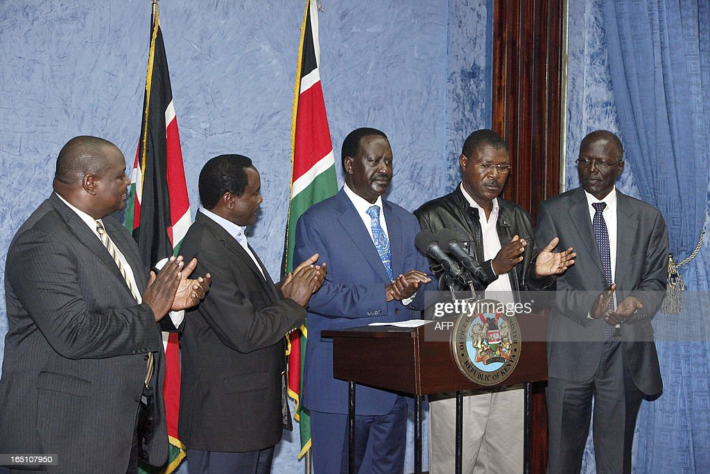 Outgoing Kenyan Prime Minister Raila Odinga (C), with Kalonzo Musyoka (2nd L) Kenya's outgoing vice president and Odinga's running mate, addresses the media at a press conference at his office in Nairobi on March 30, 2013. The Kenyan Supreme Court ruled on March 30 on a petition by outgoing Kenyan Prime Minister Raila Odinga challenging the election of contender Uhuru Kenyatta during the March 4 elections. The Supreme Court upheld the victory of Uhuru Kenyatta in the March 4 election, said Chief Justice Willy Mutunga. Odinga conceded defeat and wished Uhuru Kenyatta well in running the affairs of government. AFP PHOTO / Till Muellenmeister