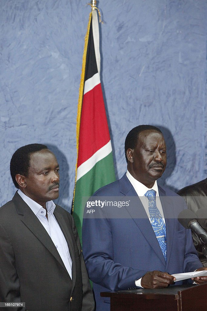 Outgoing Kenyan Prime Minister Raila Odinga (R), with Kalonzo Musyoka, Kenya's outgoing vice president and Odinga's running mate, addresses the media at a press conference at his office in Nairobi on March 30, 2013. The Kenyan Supreme Court ruled on March 30 on a petition by outgoing Kenyan Prime Minister Raila Odinga challenging the election of contender Uhuru Kenyatta during the March 4 elections. The Supreme Court upheld the victory of Uhuru Kenyatta in the March 4 election, said Chief Justice Willy Mutunga. Odinga conceded defeat and wished Uhuru Kenyatta well in running the affairs of government. AFP PHOTO / Till Muellenmeister