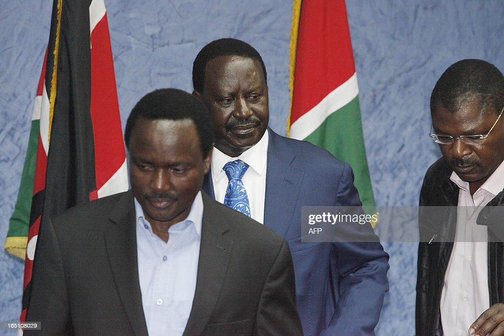 Outgoing Kenyan Prime Minister Raila Odinga (C), with Kalonzo Musyoka (L) Kenya's outgoing vice president and Odinga's running mate, leaves a press conference at his office in Nairobi after addressing the media on March 30, 2013. The Kenyan Supreme Court ruled on March 30 on a petition by outgoing Kenyan Prime Minister Raila Odinga challenging the election of contender Uhuru Kenyatta during the March 4 elections. The Supreme Court upheld the victory of Uhuru Kenyatta in the March 4 election, said Chief Justice Willy Mutunga. Odinga conceded defeat and wished Uhuru Kenyatta well in running the affairs of government. AFP PHOTO / Till Muellenmeister