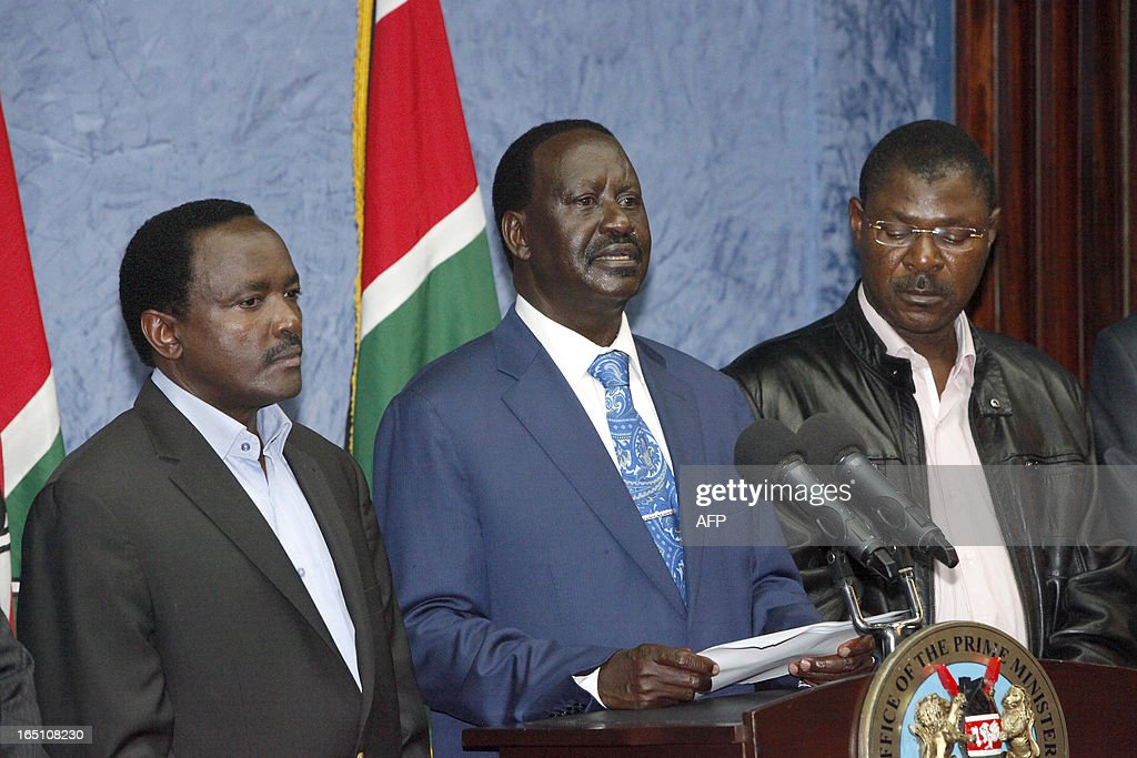 Outgoing Kenyan Prime Minister Raila Odinga (C), with Kalonzo Musyoka (L), Kenya's outgoing vice president and Odinga's running mate, addresses the media at a press conference at his office in Nairobi on March 30, 2013. The Kenyan Supreme Court ruled on March 30 on a petition by outgoing Kenyan Prime Minister Raila Odinga challenging the election of contender Uhuru Kenyatta during the March 4 elections. The Supreme Court upheld the victory of Uhuru Kenyatta in the March 4 election, said Chief Justice Willy Mutunga. Odinga conceded defeat and wished Uhuru Kenyatta well in running the affairs of government. AFP PHOTO / Till Muellenmeister