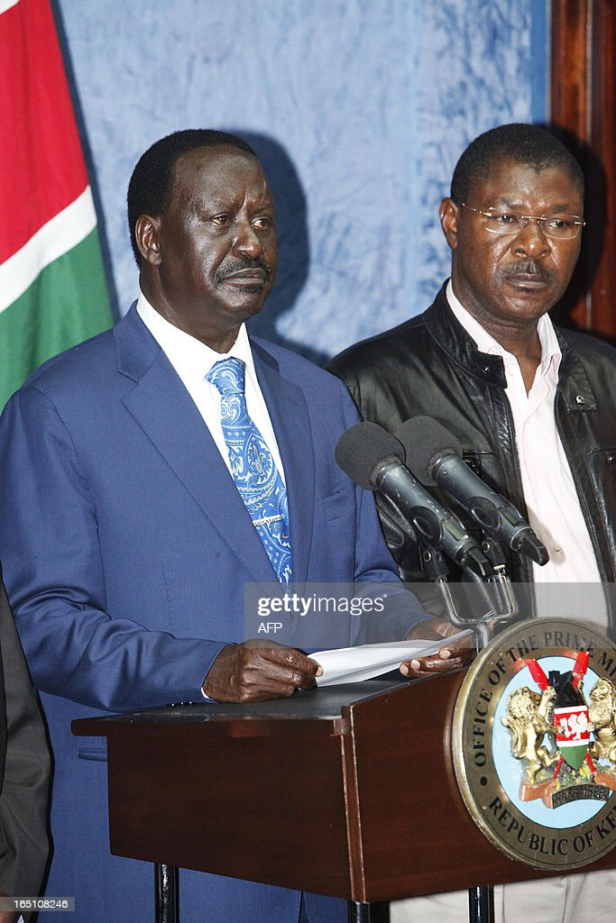 Outgoing Kenyan Prime Minister Raila Odinga (L), with Kenyan politician Moses Wetangula, addresses the media at a press conference at his office in Nairobi on March 30, 2013. The Kenyan Supreme Court ruled on March 30 on a petition by outgoing Kenyan Prime Minister Raila Odinga challenging the election of contender Uhuru Kenyatta during the March 4 elections. The Supreme Court upheld the victory of Uhuru Kenyatta in the March 4 election, said Chief Justice Willy Mutunga. Odinga conceded defeat and wished Uhuru Kenyatta well in running the affairs of government. AFP PHOTO / Till Muellenmeister