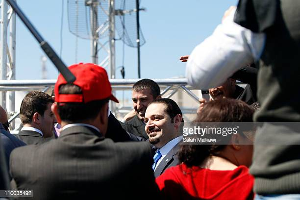 Outgoing Lebanese Prime Minister Saad Hariri joins protesters during a demonstration on March 13 2011 in Beirut Lebanon Tens of thousands of Lebanese...