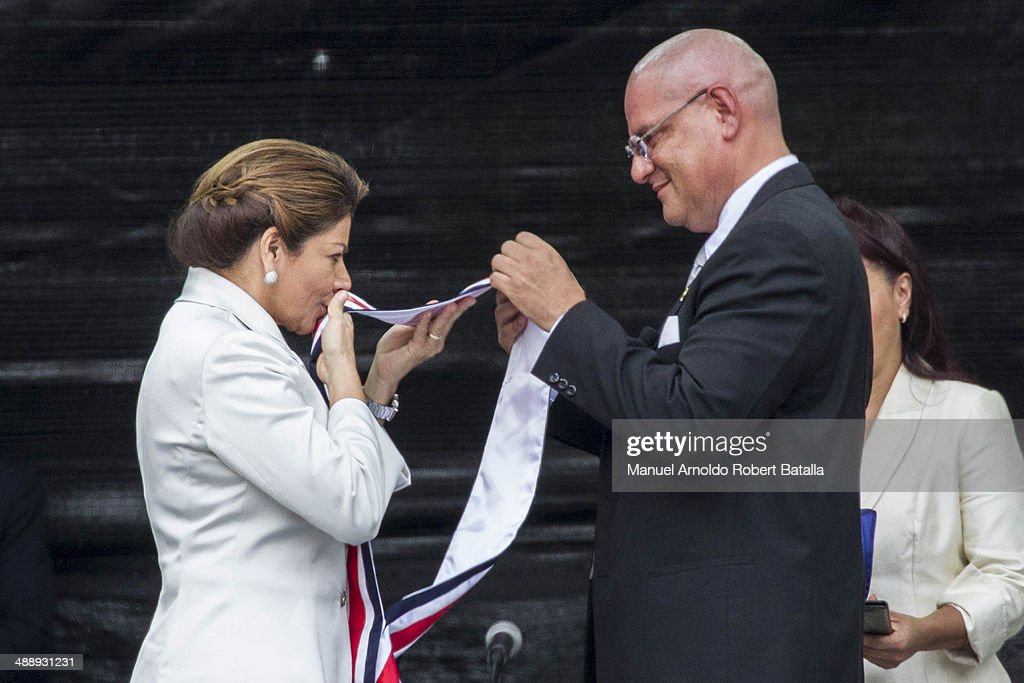 Outgoing president Laura Chinchilla kisses the presidential sash at the Inauguration Day of Costa Rica's elected President Luis Guillermo Solis at...