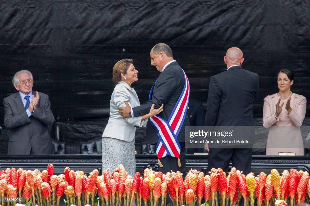 Outgoing president of Costa Rica <a gi-track='captionPersonalityLinkClicked' href=/galleries/search?phrase=Laura+Chinchilla&family=editorial&specificpeople=646370 ng-click='$event.stopPropagation()'>Laura Chinchilla</a> talks after giving the presidential sash to elected president Luis Guillermo Solis at National Stadium on May 08, 2014 in San Jose, Costa Rica. Luis Guillermo Solis was elected as the new President after winning the Presidential Election last April 06th with the 30,95% of votes, defeating his opponent Johnny Araya.